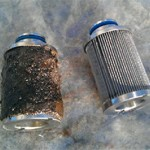 image of a contaminated and a clean fuel filter
